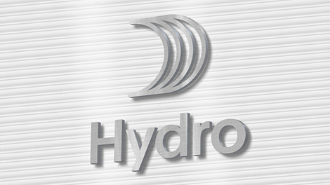 Hydro logo with sail made from metal, on a striped wall