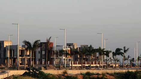 residential buildings, light poles and palms